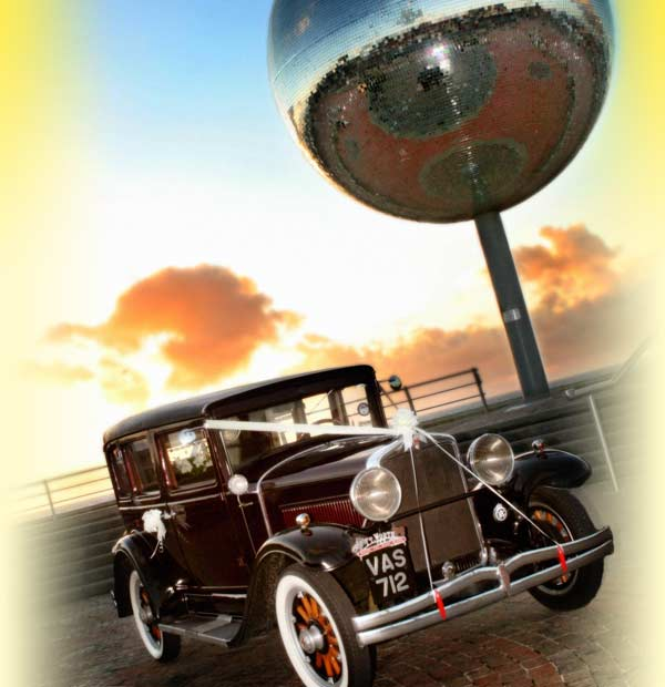 1929 Hupmobile Vintage Car on Blackpool Promenade beneath the Giant Glitter Ball